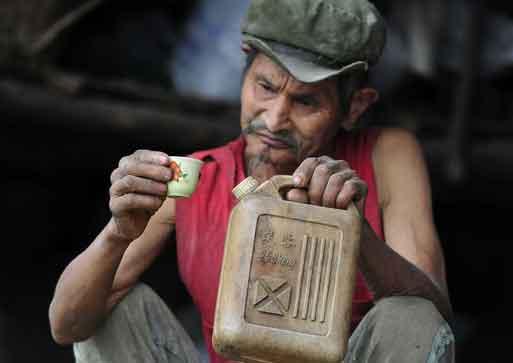 Chinese Man Chen Dejun drinks Petrol